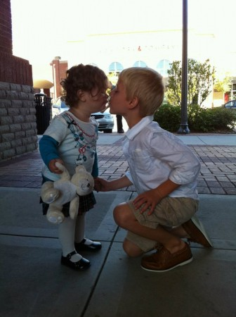 Milly kissing her cousin Jackson