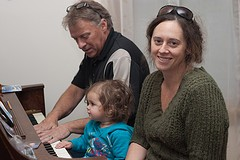 Dad, Milly and Erin at the Piano